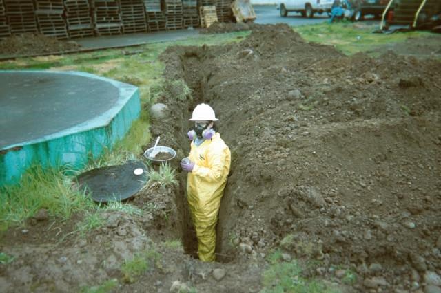 Maul Foster Alongi Worker in Hazmat Suit