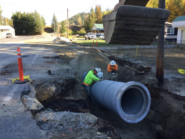Construction Workers Remove Pipe