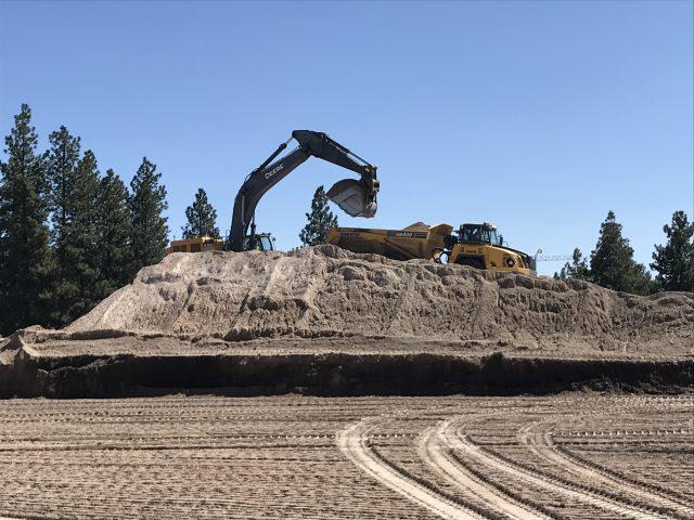 Construction Equipment Moving Soil